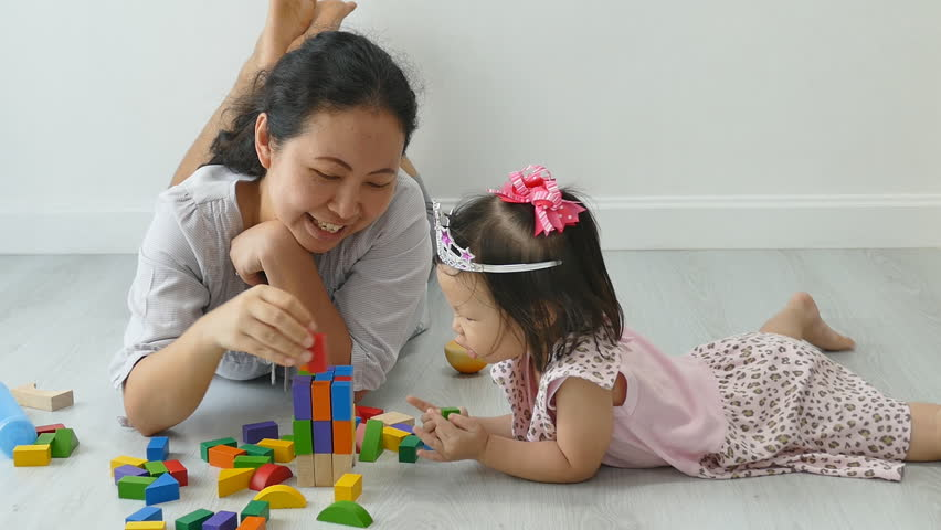 Asian Mother and Child Playing Arkivvideomateriale (100 % royaltyfritt)  13236014   Shutterstock