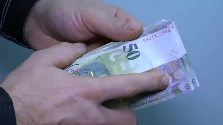 Unknown businessman counting money. | Shutterstock HD Video #13238780