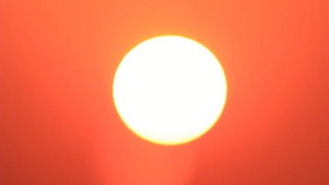 Sunrise sun at orange colored sky