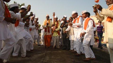 AMRAVATI, MAHARASHTRA, INDIA - November 26, 2015: Procession of Varkari-Hindu Pilgrims, Varkari which means 'pilgrim' in the local Marathi language, The Varkari worship of Vithoba an Avatar of Vishnu