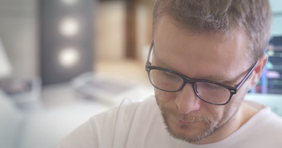 Young Man in Glasses With Concentrated Face Drips The Medicine from a Bottle, Drops Into a Cap, and Taking the Medicine, Manipulation Room,Parameters Displayed on the Screen, monitors of medical | Shutterstock HD Video #13285910