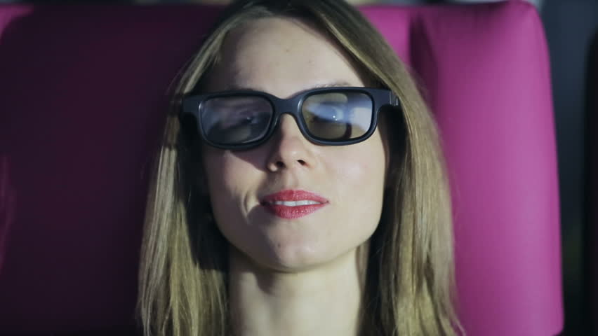 Woman in 3D glasses watching a movie at cinema | Shutterstock HD Video #13294493