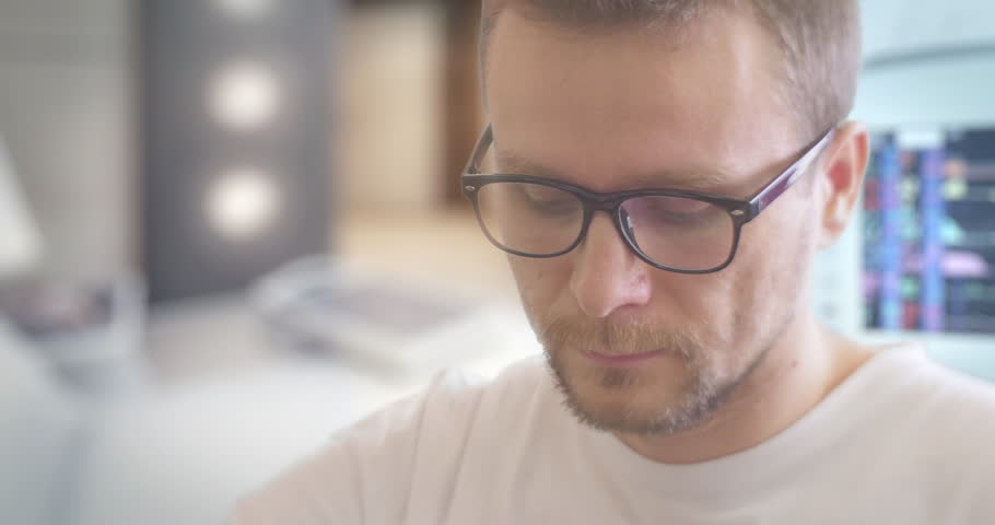 Young Man in Glasses With Concentrated Face Drips The Medicine from a Bottle, Drops Into a Cap, Going to Take Medicine, Manipulation Room,Parameters Displayed on the Screen, monitors of medical | Shutterstock HD Video #13305686