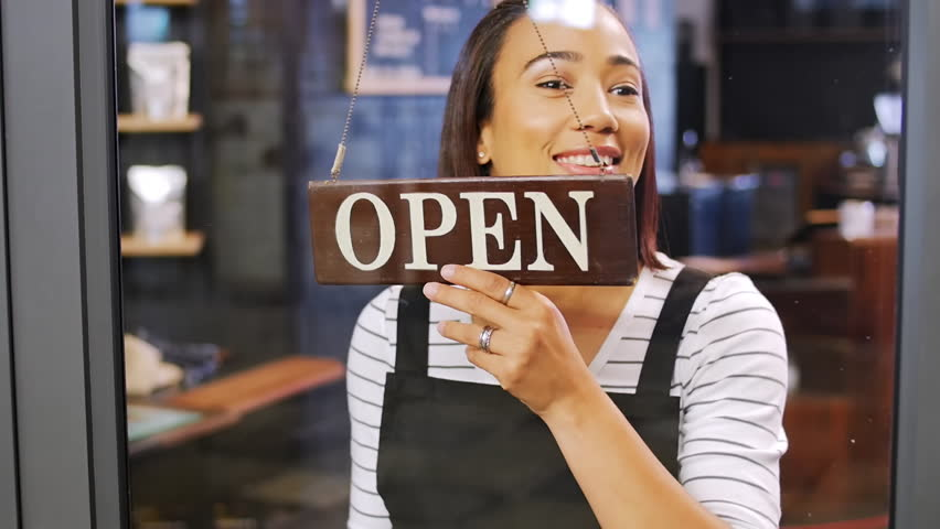 Cafe shop owner worker turning over open sign, happy and smiling first day of opening for small business   Shutterstock HD Video #13307648