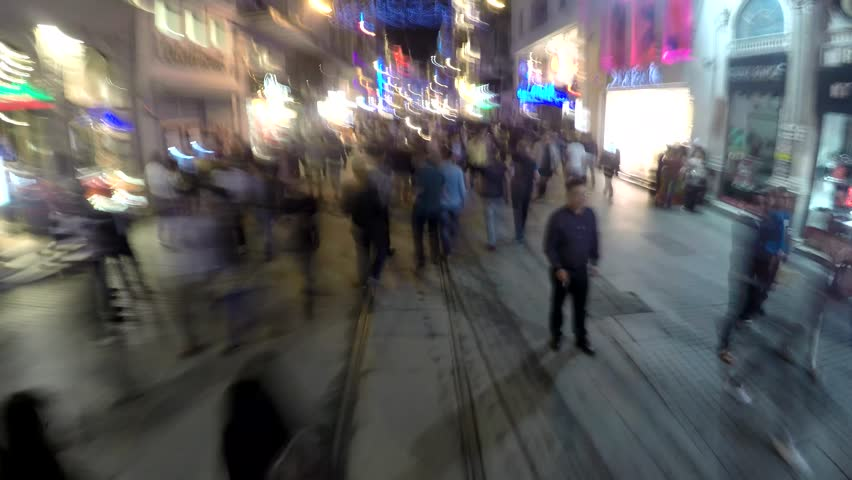 ISTANBUL, TURKEY - MAY 29, 2015:  Fast shot of walking crowd in historic Taksim Istiklal street. Istiklal Street is the most popular destination of Istanbul for shopping, entertainment and nightlife #13319300
