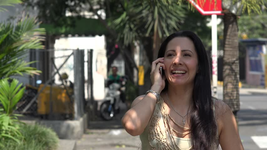 Hispanic Woman Talking on Cell Phone   Shutterstock HD Video #13325666