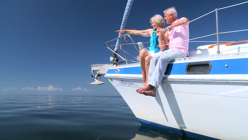 Healthy retired couple enjoying leisure aboard their luxury sailing boat filmed at 60FPS #1332673