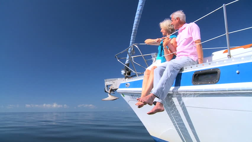 Healthy retired couple enjoying leisure aboard their luxury sailing boat filmed at 60FPS #1332676