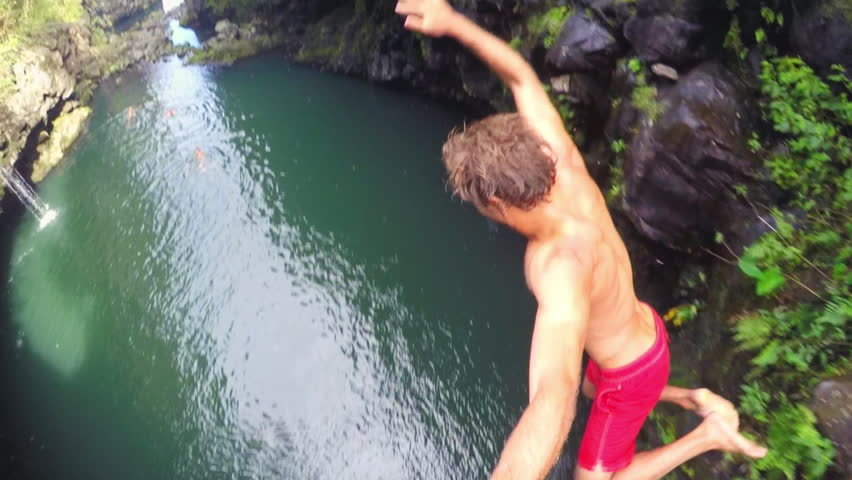 POV Slow Motion Cliff Jumping.  Lush Green Jungle in Hawaii. Extreme Sports GOPRO Selfie