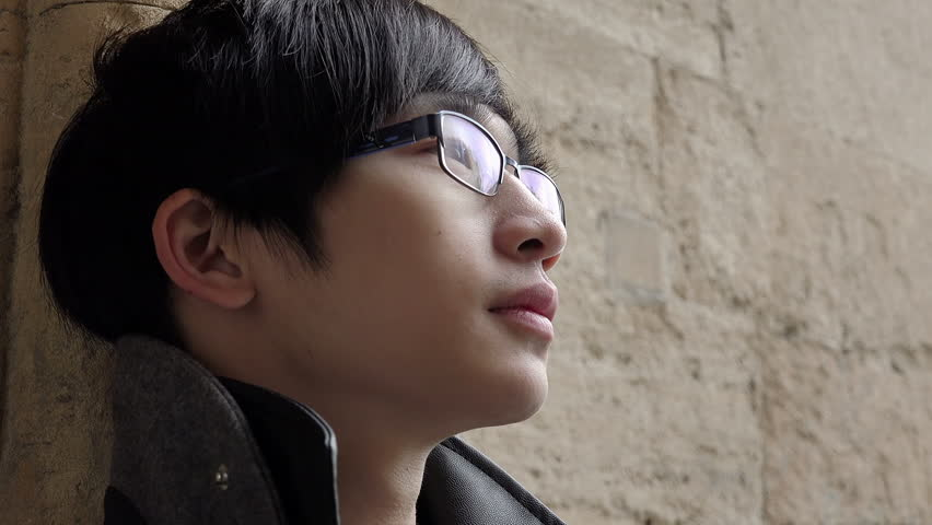 Pensive chinese man is looking away | Shutterstock HD Video #13340738