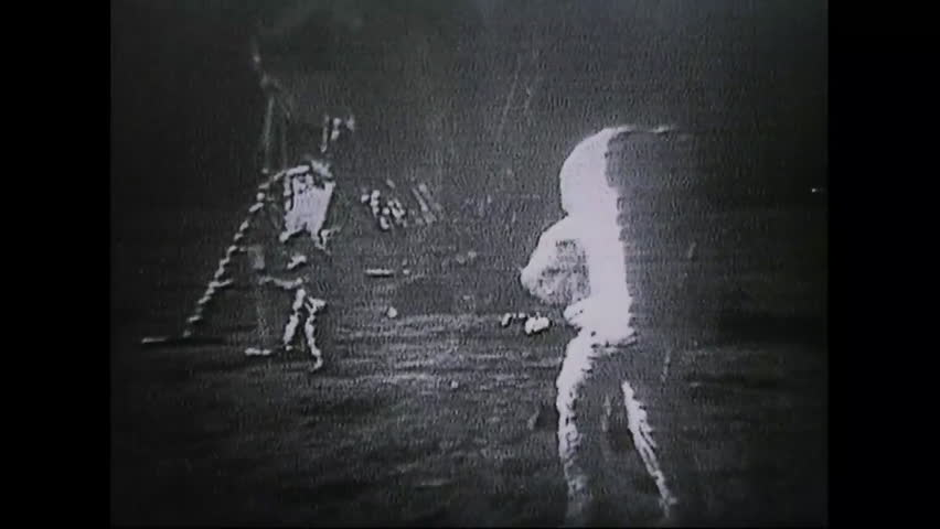 CIRCA 1970s - Astronauts from Apollo 11 walk on the moon as people watch everywhere on earth.