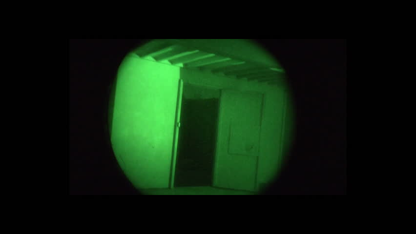 CIRCA 2010s - Night vision footage of Navy Seal personnel conducting a terrorist raid similar to the one which killed Osama Bin laden.