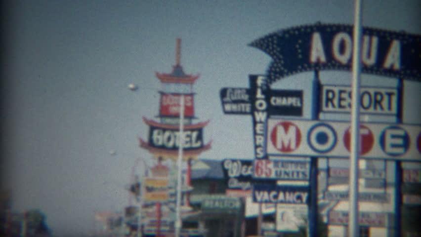 LAS VEGAS 1965: 60's retro business strip motor hotels best western Lotus Inn signs.
