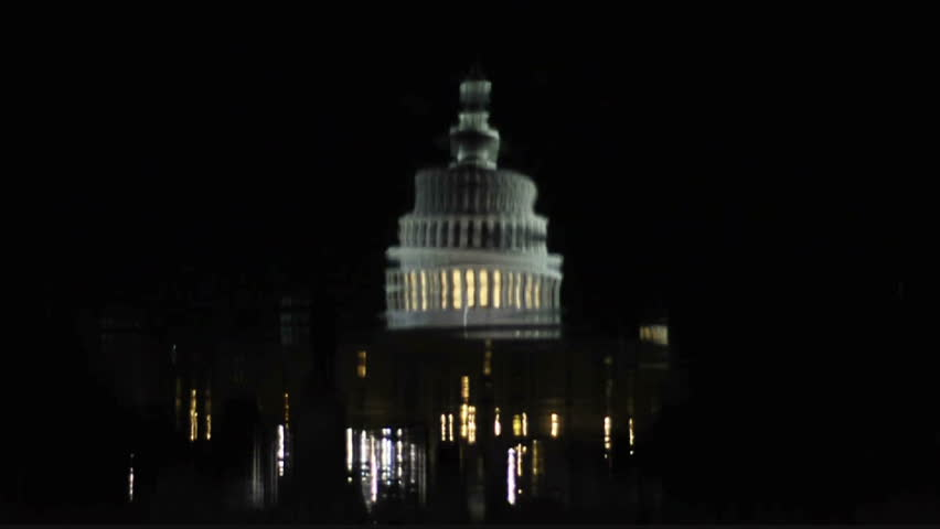 View of the Capitol building and the reflecting pool at night in Washington D.C. circa 2009