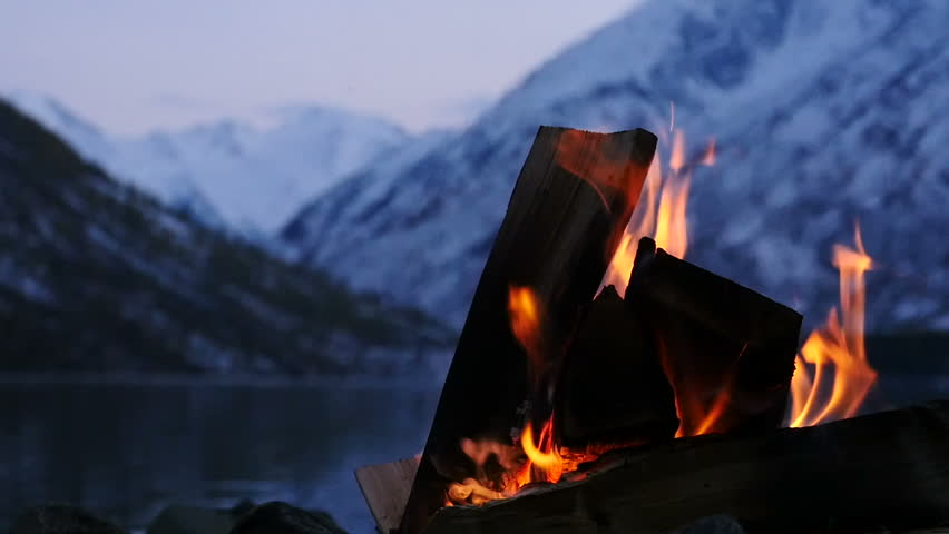 Slow Motion Stock Footage Campfire on the Lake at Twilight Royalty-Free Stock Footage #13373285