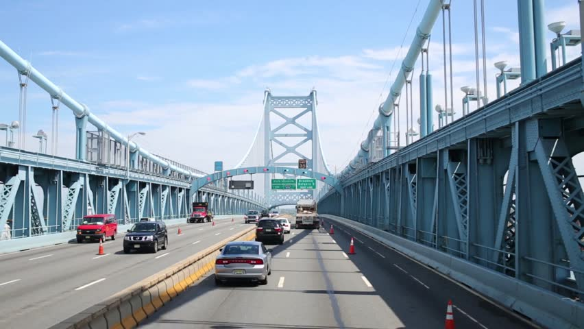 PHILADELPHIA, USA - SEPTEMBER 04, 2014: Cars moves at Benjamin Franklin Bridge at sunny day. Bridge is a suspension bridge across the Delaware River connecting Philadelphia and Camden | Shutterstock HD Video #13377899