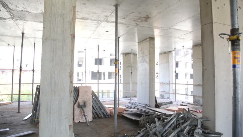 Panorama of unfinished level at construction site, few other buildings visible outside