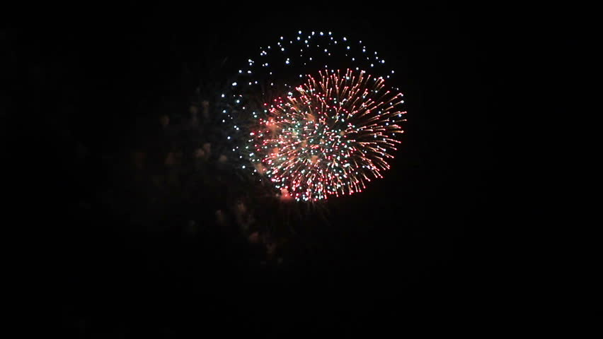 A display of fireworks in the night sky   Shutterstock HD Video #1338412