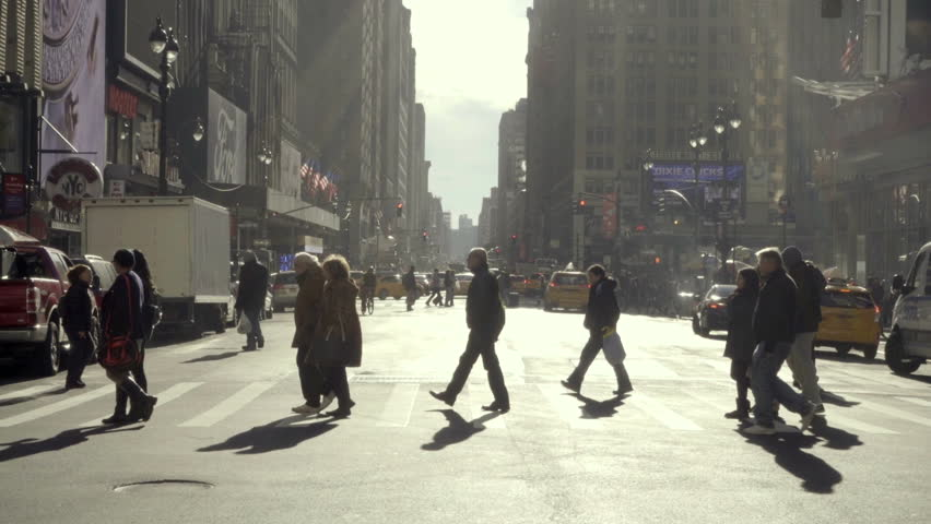 NEW YORK - NOV 29, 2015: people crossing street in slow motion, cars driving across busy intersection in Manhattan NYC. Manhattan is one of the smallest yet most populous of the 5 boroughs.   Shutterstock HD Video #13400912