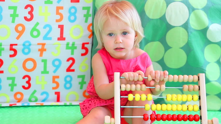 Cute baby girl counting on abacus, playing game in daycare with financial tools, elementary education. Full HD Video 1920x1080