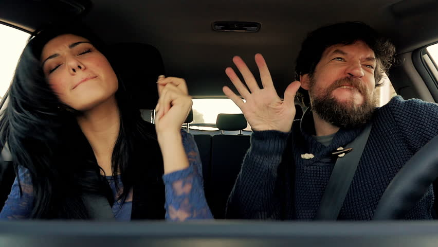 Funny man and woman dancing like crazy in car slow motion #13424207