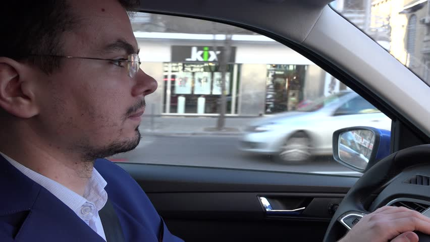 Driving to work during the day by car, focused attentive driver in traffic 4K | Shutterstock HD Video #13430612