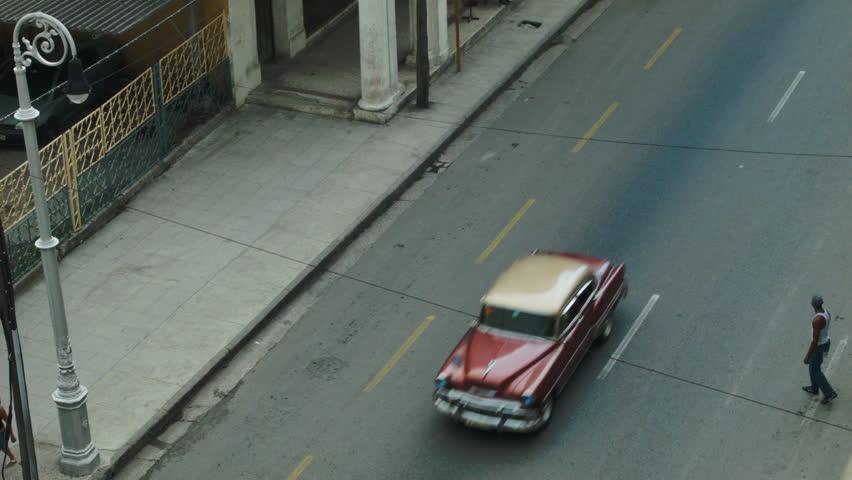 HAVANA - SEP 20, 2015:  Man crossing a busy with cars street  | Shutterstock HD Video #13433189