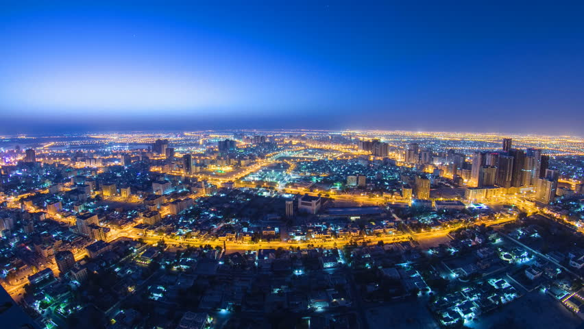 Cityscape of Ajman from rooftop from night to day transition timelapse. Ajman is the capital of the emirate of Ajman in the United Arab Emirates. fisheye 4K | Shutterstock HD Video #13439351