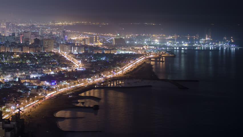 Panoramic view of Sharjah coastline at night from Ajman rooftop timelapse - third largest and most populous city in United Arab Emirates. Sharjah is located along northern coast of Persian Gulf on | Shutterstock HD Video #13439375