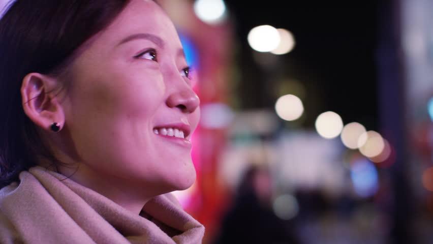 4K Young woman smiles as she watches an electronic billboard screen | Shutterstock HD Video #13486079