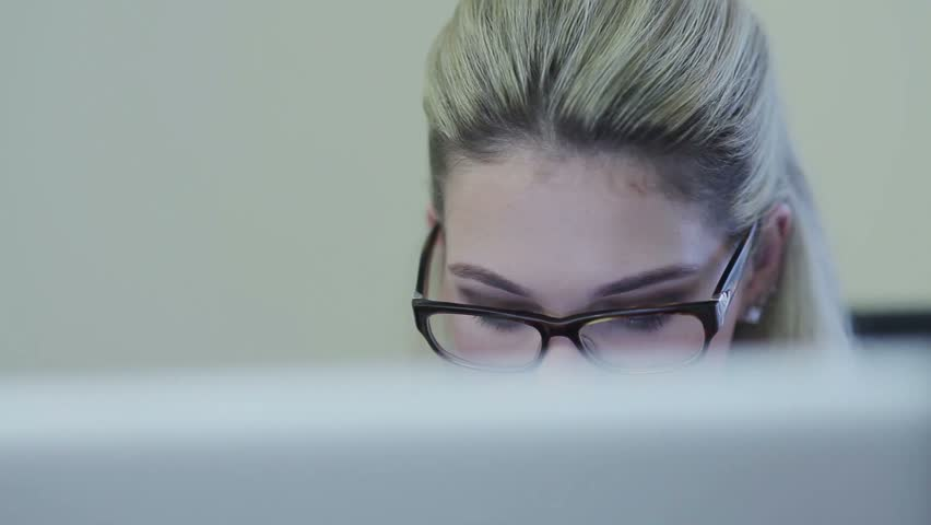 Close-up of beautiful businesslady working on laptop in office | Shutterstock HD Video #13495211