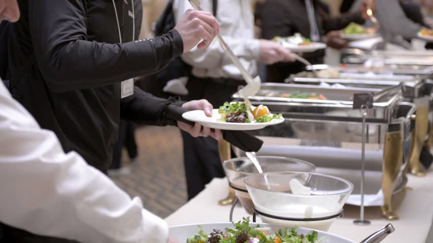 Guests attending a corporate business seminar in a hotel help themselves to the free lunch at the catered buffet table. | Shutterstock HD Video #13498856