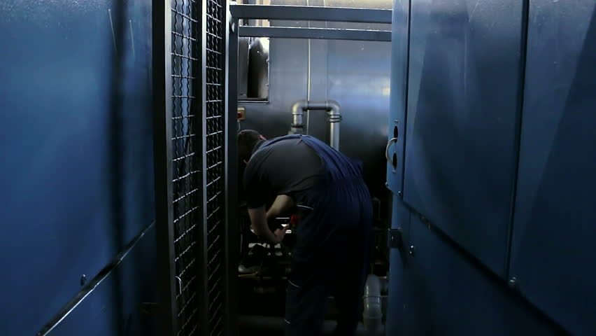 Worker controls the operation of industrial machine in the factory | Shutterstock HD Video #13514606