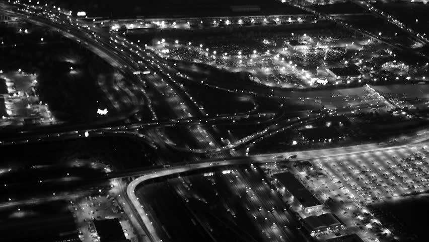 Traffic on freeway at intersection city suburbs at night. illuminated highway road. car lights traffic jam background   Shutterstock HD Video #13539794