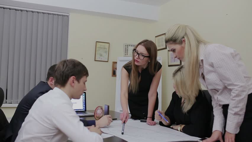 Group of architects planning on a new project in office | Shutterstock HD Video #13549358