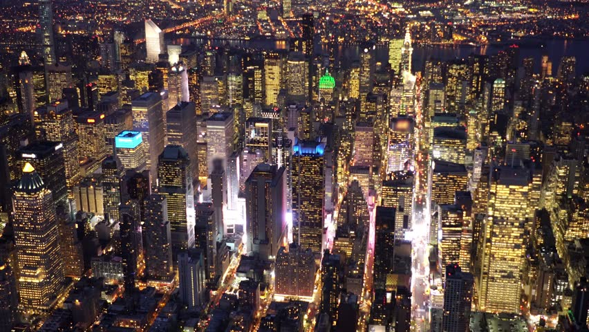 Helicopter aerial shot of new york city metropolis skyline at night. shot on red epic 4K