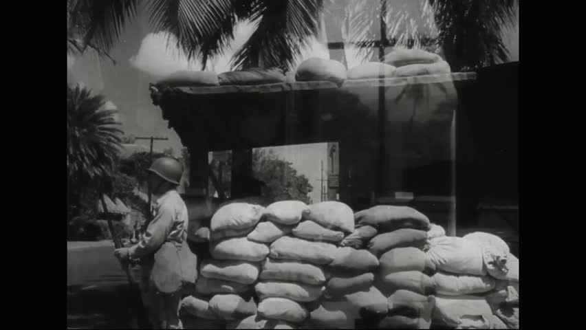 CIRCA 1940s - Martial law is declared in Hawaii following the bombing of Pearl Harbor in 1941 and barbed wire is strung along the entire coast.