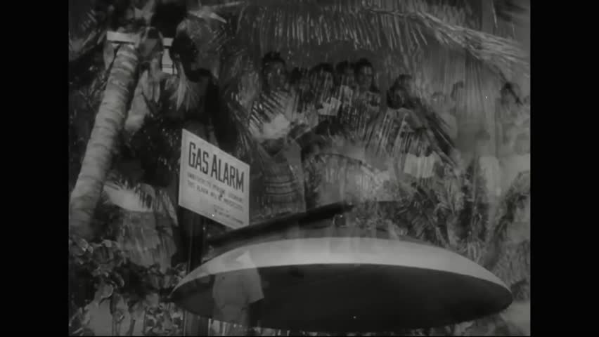 CIRCA 1940s - Martial law is declared in Hawaii following the bombing of Pearl Harbor in 1941 but the Japanese line up to give blood and buy war bonds.