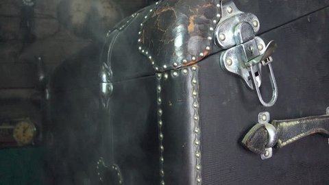 Black leather trunk with silver lock and latch. The this is a car rear trunk off a 1931 car