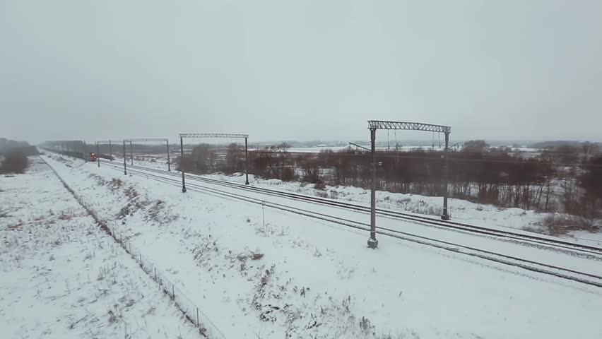 Aerial shot long freight train with many wagons on the railway in winter