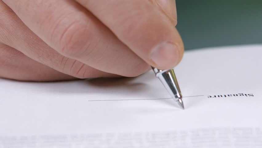 Businessman signs a document. Business deal. Signing of the contract. Signing of agreements. #13575725