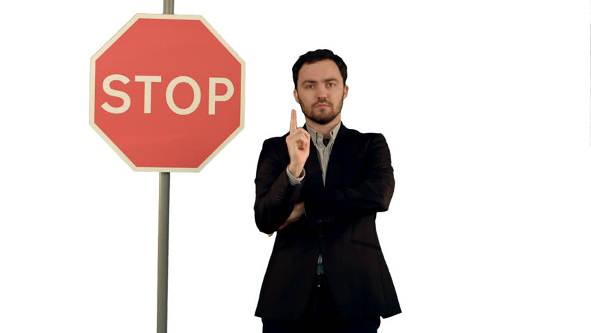 A businessman holding a stop sign on laptop on white background isolated.  | Shutterstock HD Video #13594388