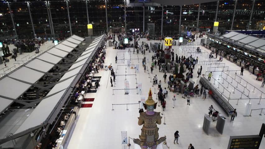 Crowd of tourist entering-leaving the Suvarnabhumi International Airport at night. | Shutterstock HD Video #13601513