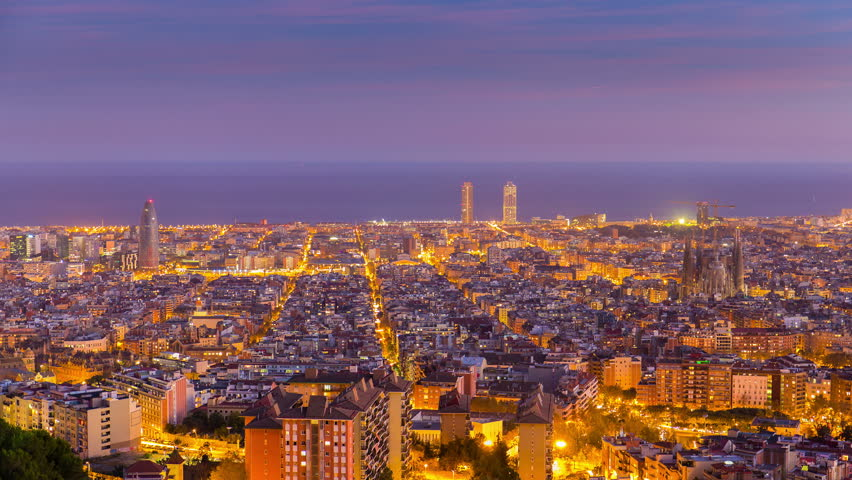 BARCELONA, SPAIN - NOVEMBER 29, 2015: Barcelona holy grail day to night 4K time lapse starting at daytime, continuing to golden hour, blue hour and ending at night.