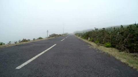 Time lapse video footage. Driving in fog on a country road on Madeira (Portugal) (POV)