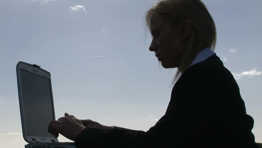 Business Woman Working Outdoors | Shutterstock HD Video #136366