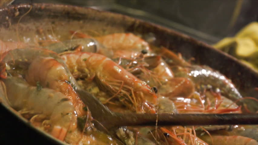 Slow motion of Gambas cooking. Find similar in our portfolio.   Shutterstock HD Video #13642007