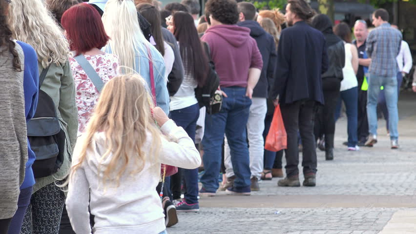 "BRISTOL, UK - AUGUST 7 2015: Bristol International Balloon Fiesta 2015: ""People queued to attend a crowded show"", Bristol, UK"