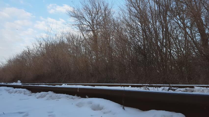 Railway tracks under winter snow.