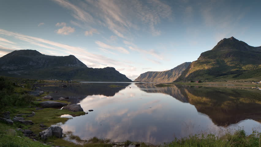 scenic timelapse of a sunset over a beautiful lake in the lofoten islands, norway